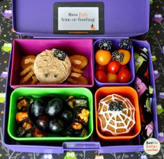 She has a spider turkey & cheese on honey wheat sandwich, sitting atop spider graham crackers. The spider's legs are NatureBox Sesame Stix, stuck on with honey. Autumn Royal grapes fill a spider silicone cup surrounded with black & orange caramel corn. She also has grape & Sunburst tomatoes, and a pumpkin & carrot muffin frosted with a spiderweb.