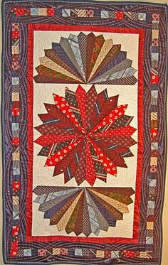 Tie Quilt by Rosie Rhine.  The wall hanging was made as a memorial.  She used the familiar Dresden fan pattern (blades not petals).