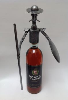 Quijote para botellas. Arte en metal reciclado.