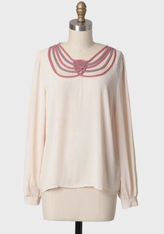 Sweet Twist Lattice Collar Blouse 36.99 at shopruche.com. Delight in this precious sheer cream chiffon top featuring a darling woven lattice collar of dusty rose and purple. Finished with buttoned cuffs, this top is great layered over a simple camisole and tucked into a high-waisted skirt for a polished...