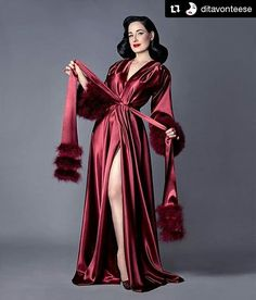 """#Repost @ditavonteese with @repostapp ・・・ #Reglam @sanchezzalba ・・・ ...another image of Dita in her Dita Von Teese Collection """"Holiday Gown"""" by Catherine D'Lish @catherinedlish in delectable Bordeaux - this one detailing the sash trimmed with plush marabou This gown also comes in a sublime celestial silver. Impeccable hair here by the hairstylist/savant Tony Medina @hisvintagetouch with makeup by the divine Dita herself! #teesetuesday #Ditavonteese #dita #catherinedlish #catherinedlishrobe…"""