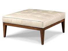 Plain and simple sums up this full top grain leather ottoman with a mahogany wood stained legs
