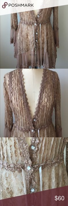 "Stunning Brown Lace Top NWOT!! This is one gorgeous top! NWOT. Measures 30"" long. Beautiful Lace. 5 Rhinestone buttons in front and a velvet tie that can be tightened at the waist. Adore Tops Blouses"