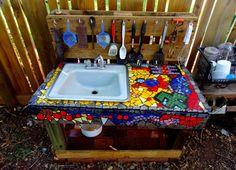 Wow - mosaic mud kitchen!