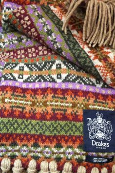 Fair Isle Scarf - this is inspirational. I could have such fun with a sampler scarf - although it would be process knitting for me, I don't wear scarves!