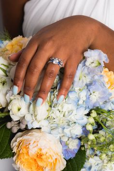 If you're all about the details, then your manicure will factor into that. You can't just wear any old pink or blush — it needs to perfectly complement your rings, skin tone, and, of course, the bouquet! Like this Something Blue color.