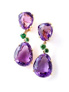 Pomellato 18K Yellow Gold Amethyst and Tsavorite Drop Earrings. Yellow Gold Earrings with Two Faceted Amethysts. There are Two Green Tsavorites in between the Amethyst Stones. Available at London Jewelers!