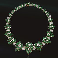 CABOCHON EMERALD AND DIAMOND NECKLACE, HARRY WINSTON.  Composed of stylized floral clusters graduating in size, alternating with pavé diamond palmettes, altogether set with 111 pear-shaped cabochon emeralds and 302 round diamonds weighing a total of approximately 20.00 carats, mounted in gold and platinum, length 16½ inches, trademark for Winston.