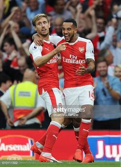 Theo Walcott celebrates scoring the 2nd Arsenal goal with Nacho Monreal during the Premier League match between Arsenal and Chelsea at Emirates...