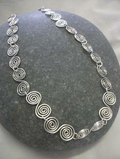 Handmade Jewellery - Necklace 23.50. A gift idea by T and M Arts and Crafts found on MyOwnCreation.co.uk: A handmade silver plated wire double spiral celtic design. (Similar to the one Alice Roberts wears in the BBC Coast series!)Measures approx. 18in