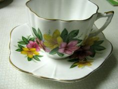 Royal Grafton Azalea Tea Cup and Saucer - white with floral pattern and gold trim