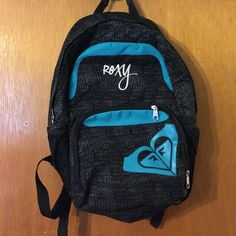 Roxy backpack This roxy backpack is in excellent condition. It has one main opening and one small pocket on the front. It has side pouches on both sides. There is one tiny black mark on the roxy sign which can barley be seen. Other than that no rips or tears! Roxy Bags Backpacks