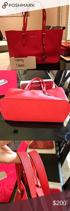 Michael Kors Tote New condition. Beautiful coral red color with gold hardware. Got a similar color bag for Christmas and no longer need this one. Will consider trading for another Tote in New or like new condition. Michael Kors Bags