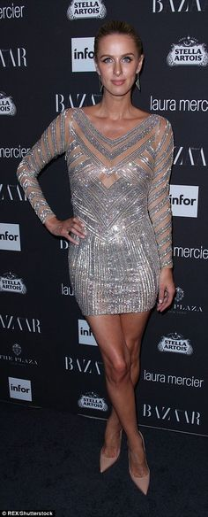 Amazing: Nicky Hilton shimmered in a silver frock that she paired with nude…