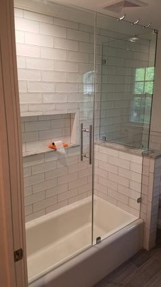 Frameless tub enclosure with ladder style pull. (888) 83-GLASS  NJGlassDoors.com