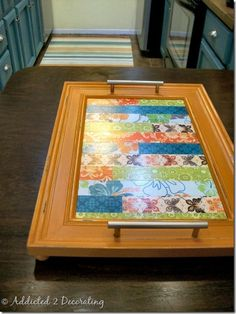 serving tray made out of an old picture frame and scrapbook paper. Could even use kids drawings