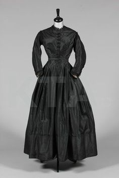 Taffeta mourning dress, mid-1860's Click to go to the absentee bidding page.  This Kerry Taylor auction will end October 16th at 2:00 PM GMT (9:00 AM EST).  You will need to register to bid ahead of time.