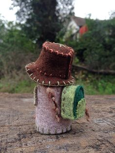 Made with felt and cotton on a winter day, this stylish mama Gnome is ready for adventures! Hat is stuffed with cotton, scarf is made out of wool and is removable, rest of outfit is secured with glue.