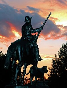 """A beautiful sunset shot of the Bass Reeves monument """"Into the Wilderness"""" in Arkansas. If you've never heard about Bass Reeves, he was one of the most feared lawmen in the Indian Territories, a US Marshall and a Black man. I should say....Bad Black Man. A true legend that some say the """"Lone Ranger"""" was partly based upon."""