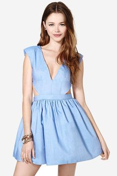 The cutest chambray dress featuring a plunging V neckline and cutout sides. Structured shoulders,...