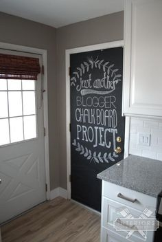 Paint a chalk board on the back door to liven things up. ONLY $9!  An easy project anyone can afford.