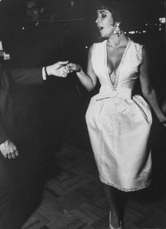 Now THIS is the way you do a plunging neckline dress. Not that slutty crap JLo wore. #ElizabethTaylor #fashion #vintage