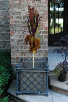 fall-centerpiece.jpg broomcorn, 3 colors of amaranthus zip tied to a stake