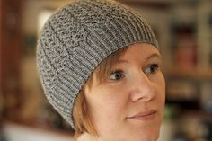 This hat draws on Gudrun's Shetland heritage, and utilizes a traditional lace pattern in a contemporary context. She also loves to design using seamless construction methods and is always adding new techniques to her seamless knitting skills.