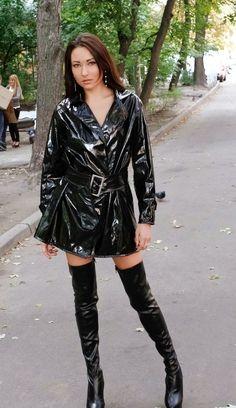 Black pvc raincoat and black thigh boots