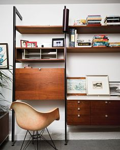 In Matt Jacobsen's Southern California ode to minimal living, the home office is decked out with an original Eames shell chair manufactured in Gardena, California, before production moved to Michigan. Photo by Dave Lauridsen. Photo by: Dave Lauridsen Mid Century Wall Unit, Modern Furniture, Furniture Design, Style Deco, Mid Century Modern Design, Mid Century Furniture, Storage Spaces, Storage Units, Interior Inspiration