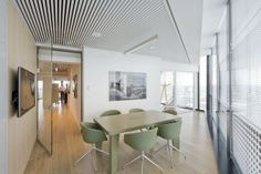 NS Stations' office discussion room. A great colour scheme & finishes selection by designers NL Architects.