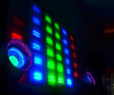 LED wall consists of a huge music equalizer, two side woofers and an amplitude controlled bulb array. The whole assembly is controlled using a TLC5916 array controlled by a MSP430 which receives serial data from a python based music processing library known as Phosphene