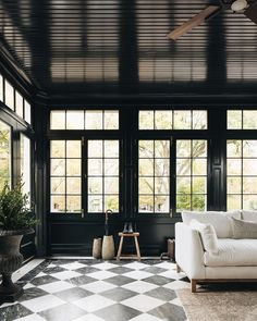 "Jean Stoffer on Instagram: ""The Madison sunroom. Many years ago I saw an ancient English conservatory with blackish green walls and windows and a black and white…"" Ancient English, Four Seasons Room, Checkered Floors, Window Casing, English House, Dark Walls, Dream Home Design, Bright, Common Area"