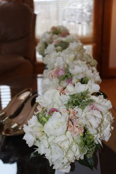 Bridal bouquets and Kate Spade gold glitter shoes