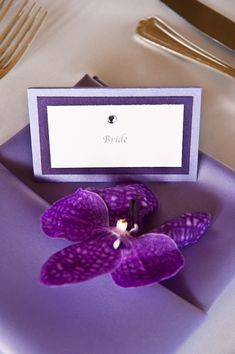 lavender and purple table setting with place card for Bride and purple flower accent - Honolulu destination wedding photo by top Hawaiian wedding photographer Derek Wong
