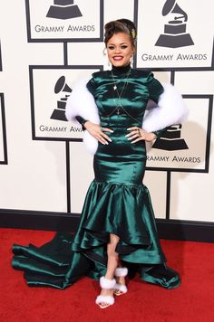 Andra Day in an emerald green mullet dress with white furry heels at the 58th Grammy Awards at Staples Center in Los Angeles, California, on February 15, 2016.