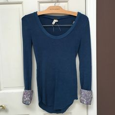 We the Free Blue Thermal reversible cuffs Great condition! Don't love this color for me. The cuffs can be flipped to a floral pattern Free People Tops Tees - Long Sleeve