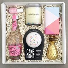 Contents - Birthday cake scented candle with wax confetti by The Little Market - Cake scented bath bomb with sprinkles by Da Bomb Fizzers with hidden surprise inside! - One gold celebratory shot glass