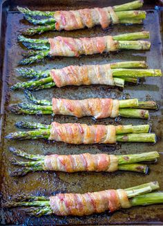 Bacon Wrapped Asparagus {A Delicious and Easy Side Dish Recipe}. Made it: used thick bacon so had to cook for then broil on high. Asparagus cooked too much but taste was there. Try thinner bacon next time Asparagus Side Dish, Asparagus Bacon, How To Cook Asparagus, Bacon Wrapped Asparagus Baked, Asparagus On The Grill, Steak And Asparagus Recipe, Asparagus Appetizer, Grilled Asparagus Recipes, Asparagus Tart