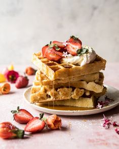Overnight Waffles with whipped Meyer lemon cream and strawberries, plus real maple syrup.