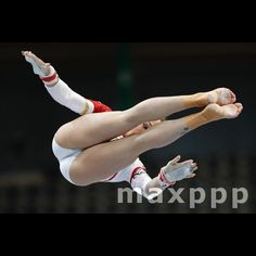 Giulia Steingruber of Switzerland performs on the uneven bars during the Women's qualifications at the European Men's and Women's Artistic Gymnastics Championships at the Postfinance Arena in Bern, Switzerland, 02 June 2016.  EPA/PETER KLAUNZER (MaxPPP #photo #photos #pic #pics #picture #pictures #art #beautiful #instagood #picoftheday #photooftheday #color #exposure #composition #focus #capture #moment #sport #photojournalism #photojournalisme #maxppp #gymnastics