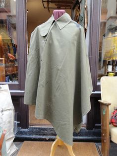 Vintage 1950s waterproof khaki canvas British army military gas foul weather rain cape poncho groundsheet button up broad arrow stamped by TheDustbowlVintage on Etsy https://www.etsy.com/listing/221593851/vintage-1950s-waterproof-khaki-canvas