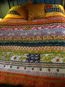beautiful bedspread made of upcycled saris.  LOVE!