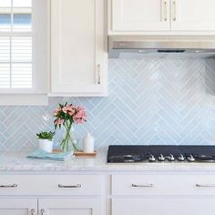 29 Top Kitchen Splashback Ideas for Your Dream Home - Herringbone Splashback Would you like to update your kitchen without undergoing a full remodel? Check out our top kitchen splashback ideas to get inspiration! Backsplash For White Cabinets, Kitchen Countertops, Backsplash Ideas, Blue Kitchen Backsplash, Marble Countertops, Tile Ideas, Kitchen Splashback Ideas, Glass Subway Tile Backsplash, Kitchen Remodeling
