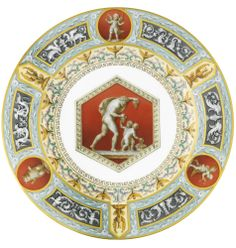A PORCELAIN DINNER PLATE FROM THE RAPHAEL SERVICE, IMPERIAL PORCELAIN MANUFACTORY, ST PETERSBURG, PERIOD OF NICHOLAS II (1896-1917), DATED 1897 the cavetto painted en grisaille with Bacchus and two putti on iron red ground in a hexagonal reserve, the rim border with three roundels depicting Marsyas, a putto and a mythological creature within classical friezes, with gilt Imperial cypher for Nicholas II dated 1897 diameter 24cm, 9 1/2 in.