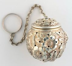 My tea ball just broke, so it would be great to get another. This one is beautiful, so I added it, but a plain one is great too. Stieff Sterling Tea Ball.