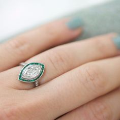 Art Deco Marquise Diamond Engagement Ring with Emerald Halo