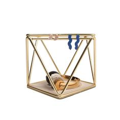 You can drape jewelry from the bars or place bigger pieces in the center. Or just leave it out as an elegant objet d'art.