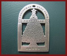 1994: A large tree in a window for celebrating 50 years of Harvest-Your-Own trees at Jones farms. The first ornament with the year printed on it.