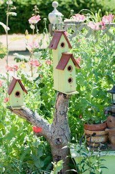Pic: An old tree stump plays host to little yellow bird houses Bird Boxes, Fairy Houses, Dream Garden, Yard Art, Beautiful Birds, Garden Inspiration, Garden Ideas, Bird Feeders, Outdoor Gardens